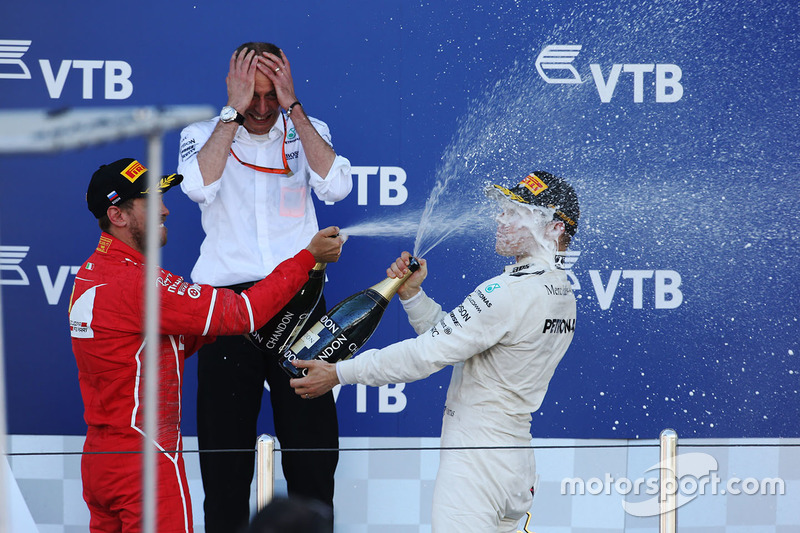 Race winner Valtteri Bottas, Mercedes AMG F1, is sprayed, Champagne by himself and Second place Sebastian Vettel, Ferrari