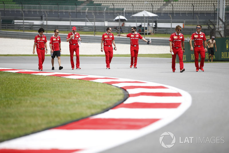 Sebastian Vettel, Ferrari, walks the track, colleagues