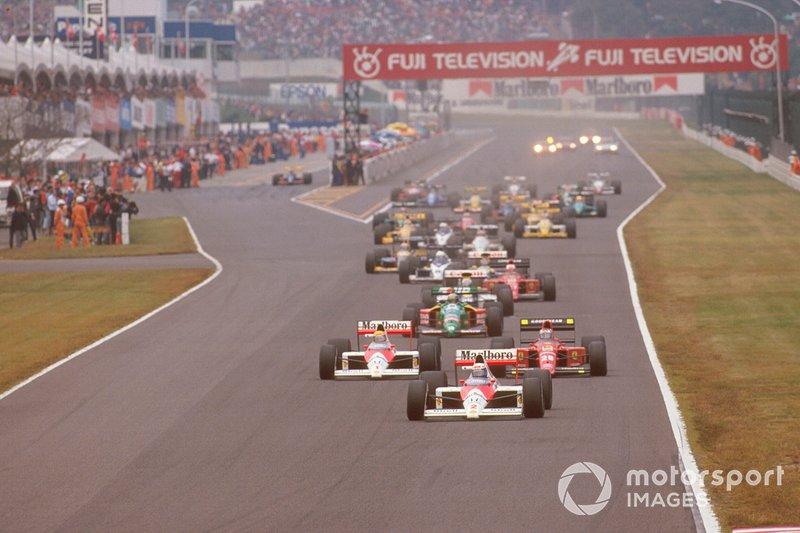 Alain Prost, McLaren leads Ayrton Senna at the start