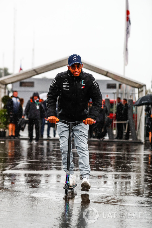 Lewis Hamilton, Mercedes AMG F1, arrives in the paddock