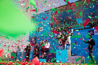 Confetti rains down as Robin Frijns, Envision Virgin Racing, 2nd position, Jérôme d'Ambrosio, Mahindra Racing, 1st position, Sam Bird, Envision Virgin Racing, 3rd position, celebrate on the podium