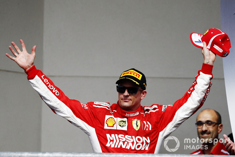 Kimi Raikkonen, Ferrari, 1st position, arrives on the podium