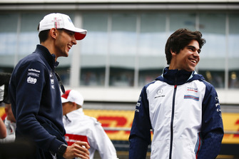 Esteban Ocon, Racing Point Force India and Lance Stroll, Williams Racing laughing Andy Hone