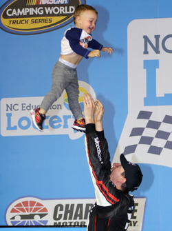 Race winner Kyle Busch, Kyle Busch Motorsports Toyota, tosses his son, Brexton, in the air