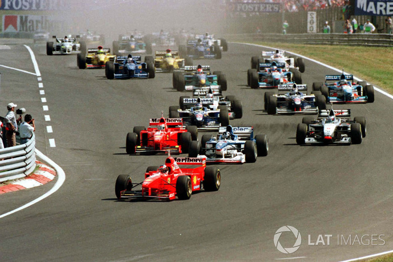 Michael Schumacher leads away the field at the start of the race, just ahead of Damon Hill