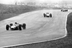 Graham Hill, Lotus 49-Ford, leads Jack Brabham, Brabham BT24-Repco, and Jackie Stewart, BRM P83