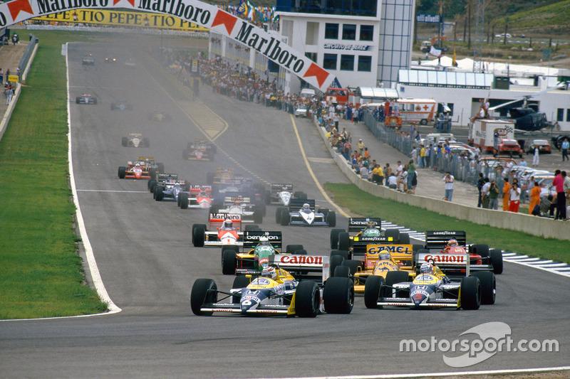 Départ : Nelson Piquet, Williams FW11B Honda et Nigel Mansell, Williams FW11B Honda, devant Ayrton Senna, Lotus 99T Honda