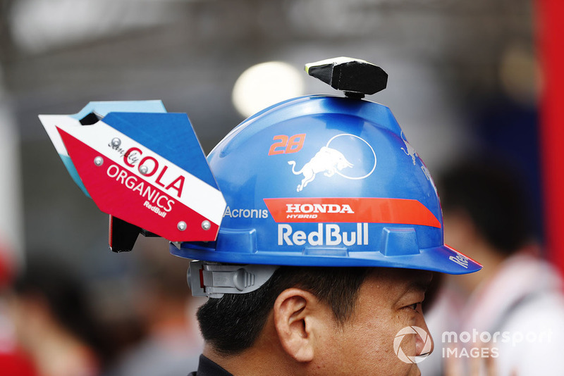 A fan with a Toro Rosso themed hat