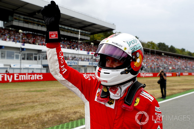 Vettel celebrates pole, typically in Italian