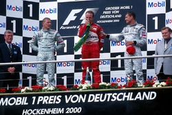 Mika Hakkinen, McLaren 2nd, race winner Rubens Barrichello, Ferrari and David Coulthard, McLaren 3rd