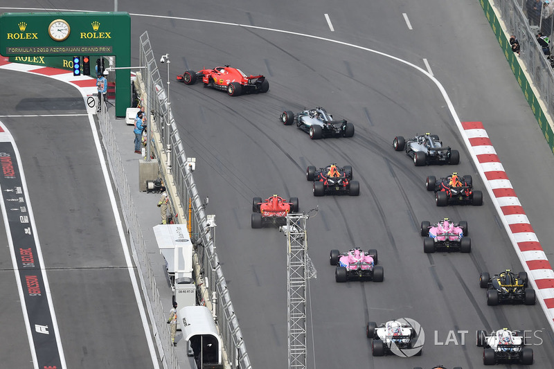 Sebastian Vettel, Ferrari SF71H leads at the start of the race