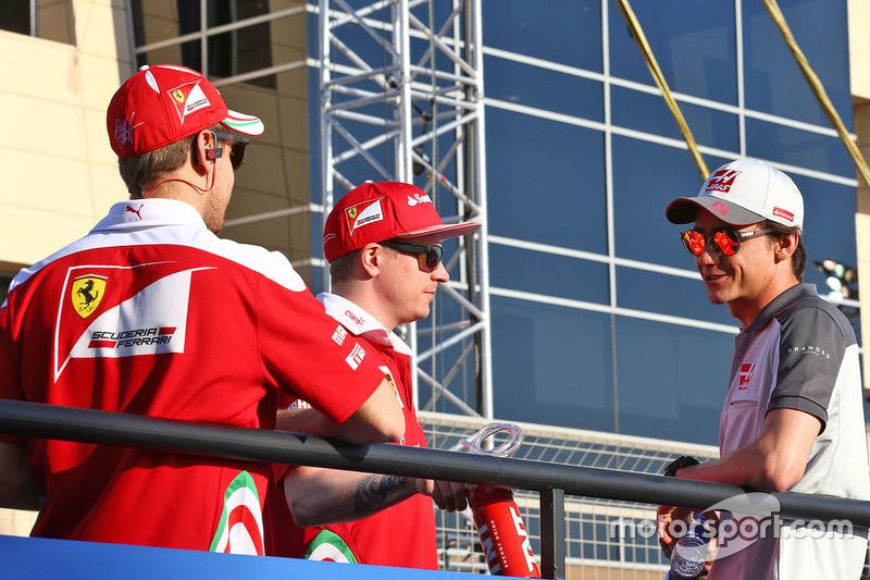 Sebastian Vettel, Ferrari, Kimi Raikkonen, Ferrari and Esteban Gutierrez, Haas F1 Team
