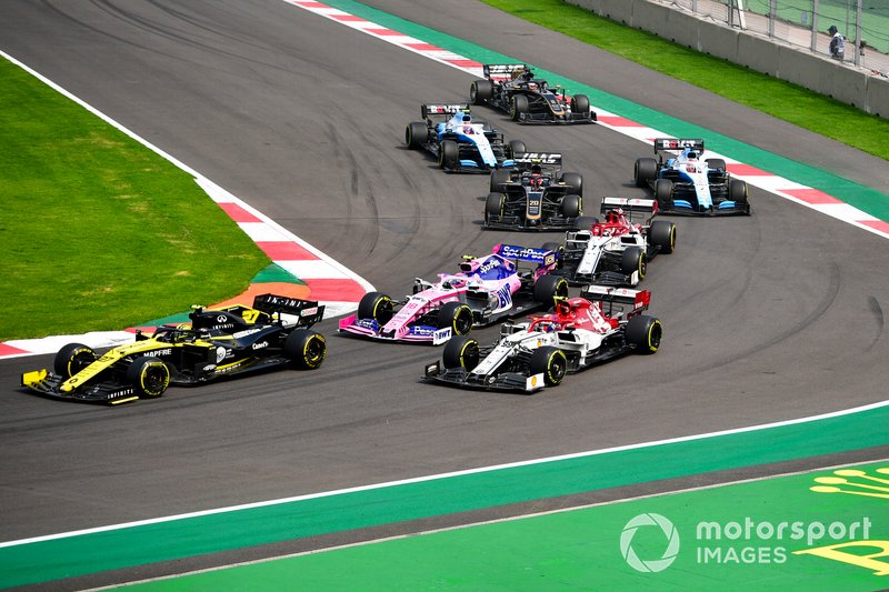 Nico Hulkenberg, Renault F1 Team R.S. 19, leads Antonio Giovinazzi, Alfa Romeo Racing C38, Lance Stroll, Racing Point RP19, Kimi Raikkonen, Alfa Romeo Racing C38, Kevin Magnussen, Haas F1 Team VF-19, George Russell, Williams Racing FW42, Robert Kubica, Williams FW42, and Romain Grosjean, Haas F1 Team VF-19, at the start
