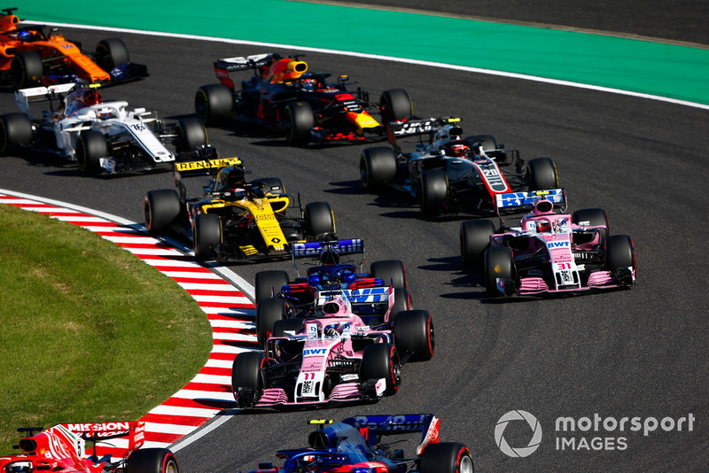 Sergio Perez, Racing Point Force India VJM11, Brendon Hartley, Toro Rosso STR13, Esteban Ocon, Racing Point Force India VJM11, Carlos Sainz Jr., Renault Sport F1 Team R.S. 18, Kevin Magnussen, Haas F1 Team VF-18, Charles Leclerc, Sauber C37, Daniel Ricciardo, Red Bull Racing RB14, and Fernando Alonso, McLaren MCL33, at the start