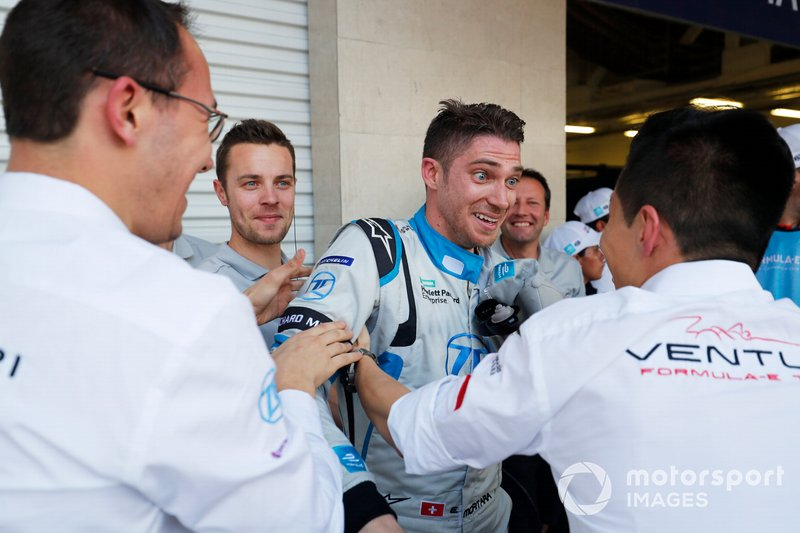 A surprised Edoardo Mortara Venturi Formula E celebrates his 3rd position with his team in parc ferme