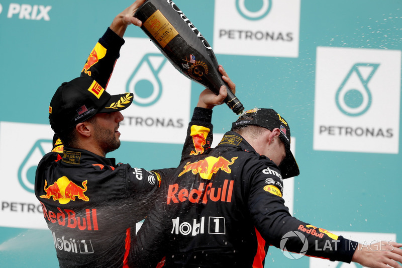Third place Daniel Ricciardo, Red Bull Racing, pours Champagne down the back of team mate Max Verstappen, Red Bull Racing, race winner, on the podium