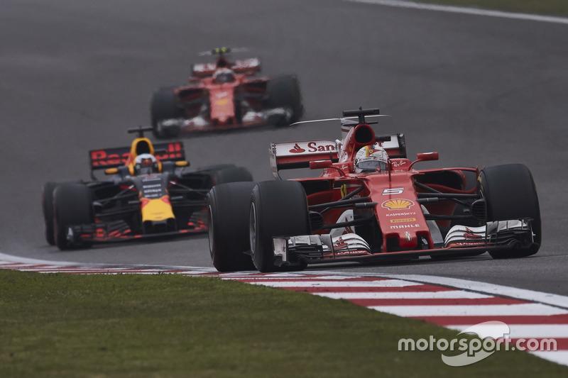 Sebastian Vettel, Ferrari SF70H, leads Daniel Ricciardo, Red Bull Racing RB13, and Kimi Raikkonen, F