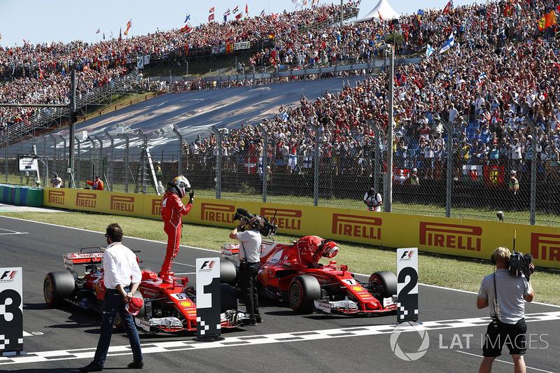 Il poleman Sebastian Vettel, Ferrari, il secondo qualificato Kimi Raikkonen, Ferrari