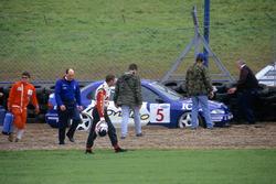 Nigel Mansell looks at his damaged car after his crash at Craner