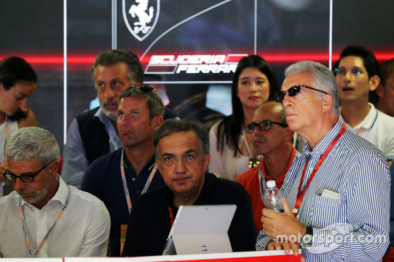 Sergio Marchionne, Ferrari President and CEO of Fiat Chrysler Automobiles (Centre) and Piero Ferrari, Ferrari Vice-President (Right) watch qualifying