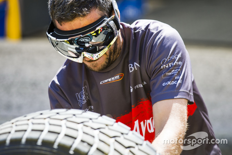 A Pertamina Campos Racing mechanic, wearing reflecting goggles