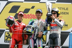 Podium: second place Cases Stoner, Ducati; Winner Valentino Rossi, Yamaha; third place Nicky Hayden, Honda