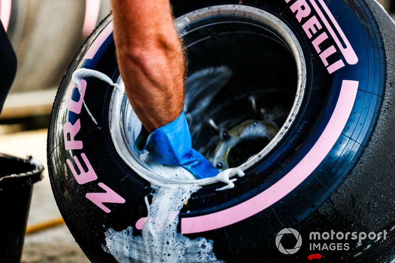 An engineer washes a Pirelli Hypersoft tyre
