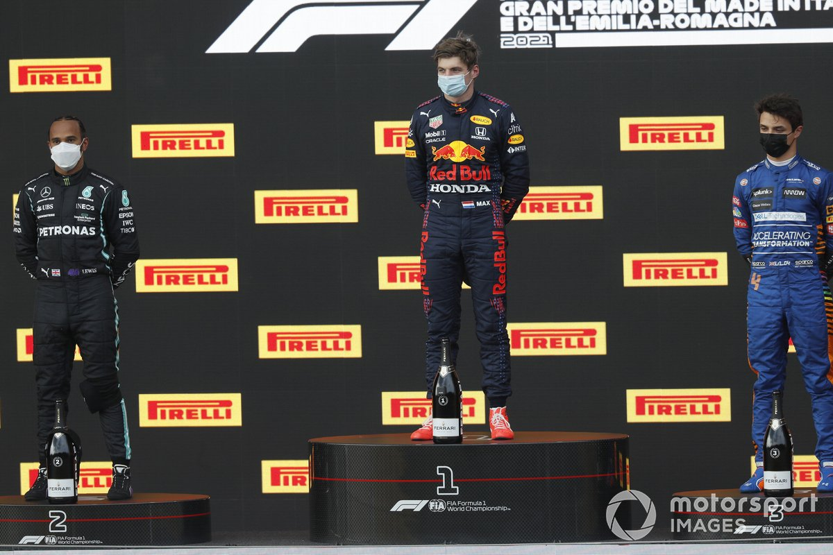 Lewis Hamilton, Mercedes, 2nd position, Max Verstappen, Red Bull Racing, 1st position, and Lando Norris, McLaren, 3rd position, on the podium