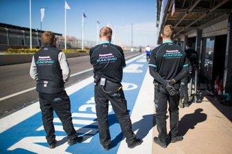 Panasonic Jaguar Racing team outside the garage