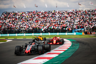 Кевин Магнуссен, Haas F1 Team VF-18, Кими Райкконен, Ferrari SF71H, и Стоффель Вандорн, McLaren MCL33