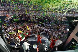 A burst of ticker tape covers the podium. Race winner Sebastian Vettel, Ferrari, 1st Position, celebrates with Luigi Fraboni, Head of Power Unit Race Operation, Ferrari. The pair are joined by Lewis Hamilton, Mercedes AMG, 2nd Position, and Valtteri Bottas