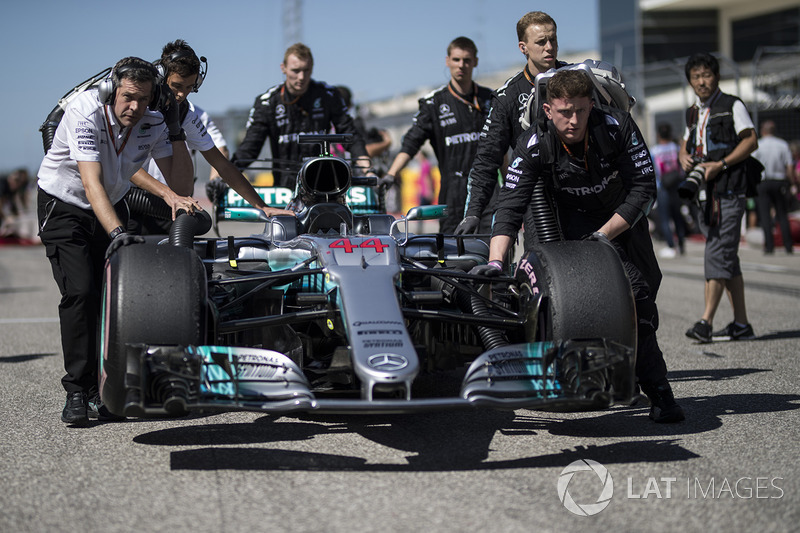 The car of Lewis Hamilton, Mercedes-Benz F1 W08  is pushed by mechanics
