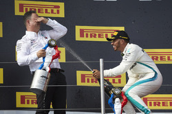 Lewis Hamilton, Mercedes AMG F1, 1st position, sprays Champagne at Ron Meadows, Sporting Director, Mercedes AMG, on the podium