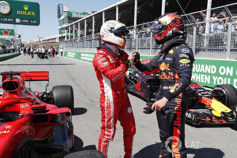 Pole sitter Sebastian Vettel, Ferrari and Max Verstappen, Red Bull Racing celebrate in parc ferme