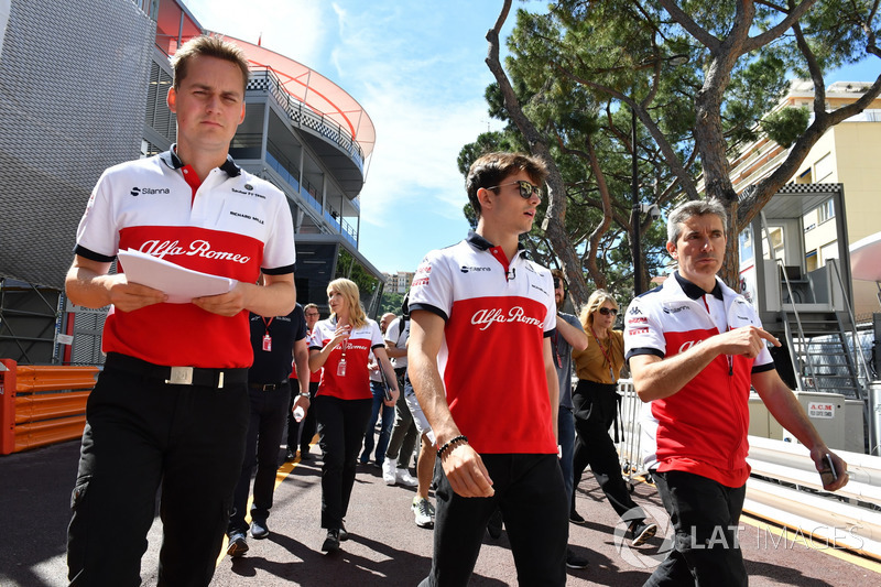 Charles Leclerc, Sauber and Xevi Pujolar, Sauber Head of Track Engineering walk the track