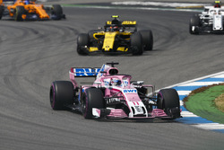 Sergio Perez, Force India VJM11, leads Carlos Sainz Jr., Renault Sport F1 Team R.S. 18, and Charles Leclerc, Sauber C37