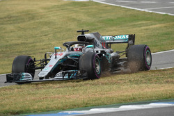 Lewis Hamilton, Mercedes-AMG F1 W09 goes across the grass at pit lane entry
