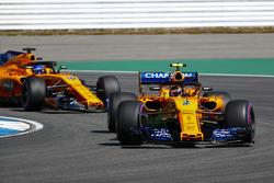 Stoffel Vandoorne, McLaren MCL33, leads Fernando Alonso, McLaren MCL33