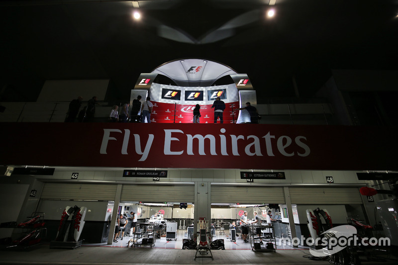 The podium and Haas F1 Team pit garages at night