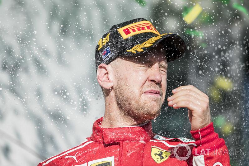 Sebastian Vettel, Ferrari, 1st position, celebrates on the podium with Champagne