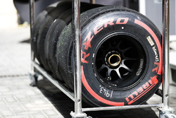Red, soft, Pirelli tyres in a trolley rack