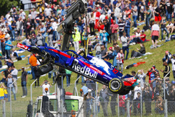 The damaged Pierre Gasly Toro Rosso STR13 is craned off the circuit