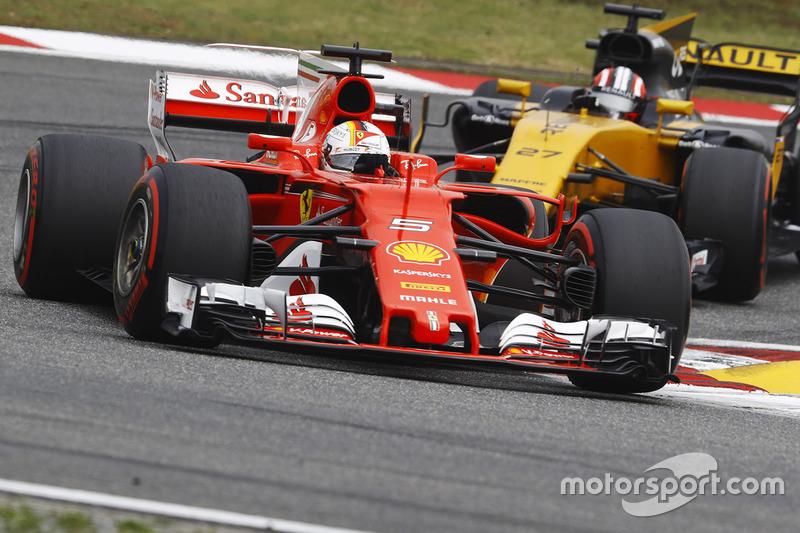 Sebastian Vettel, Ferrari SF70H, leads Nico Hulkenberg, Renault Sport F1 Team RS17