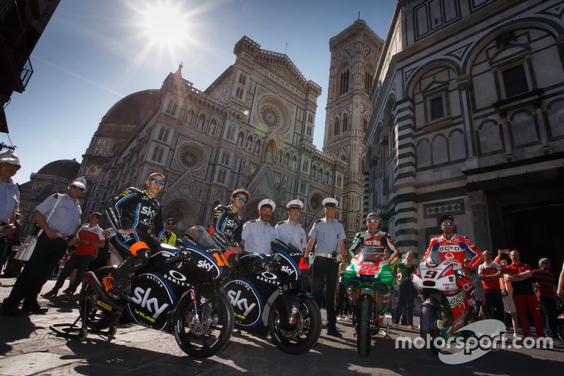 Andrea Migno, Francesco Bagnaia, Sam Lowes, Aprilia Racing Team Gresini, and Danilo Petrucci, Pramac Racing in front of Firenze's spectacular Duomo