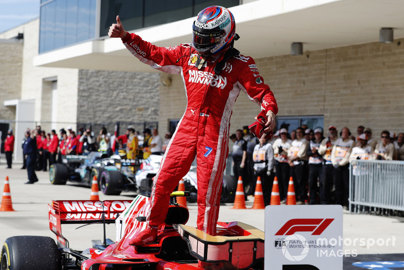 Kimi Raikkonen, Ferrari SF71H, celebrates in Parc Ferme after winning the race