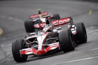Fernando Alonso, McLaren MP4-22, leads team mate Lewis Hamilton, McLaren MP4-22