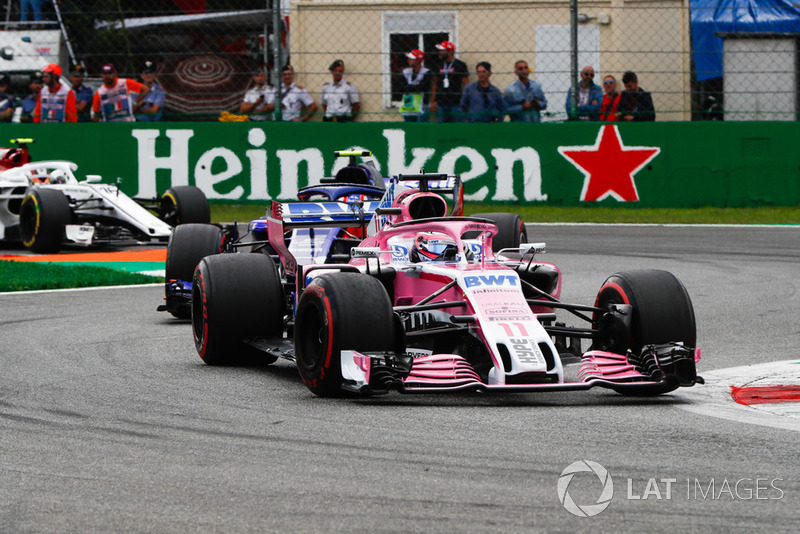 Sergio Perez, Racing Point Force India VJM11, leads Pierre Gasly, Toro Rosso STR13, and Charles Leclerc, Sauber C37