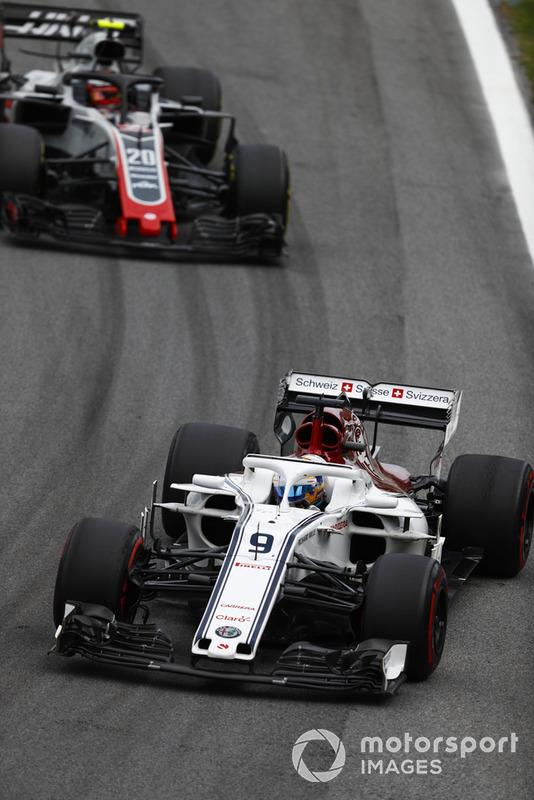 Marcus Ericsson, Sauber C37 Ferrari, leads Kevin Magnussen, Haas F1 Team VF-18 Ferrari.