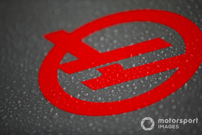 Haas F1 logo with rain water