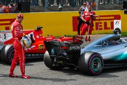 Sebastian Vettel, Ferrari looks at the Mercedes-Benz F1 W08  in parc ferme